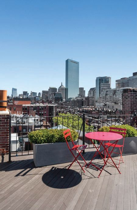 The rooftop deck gives homeowners an escape from the city at 290 Commonwealth Ave. COURTESY OF RYAN GLASS, GIBSON SOTHEBY'S INTERNATIONAL REALTY