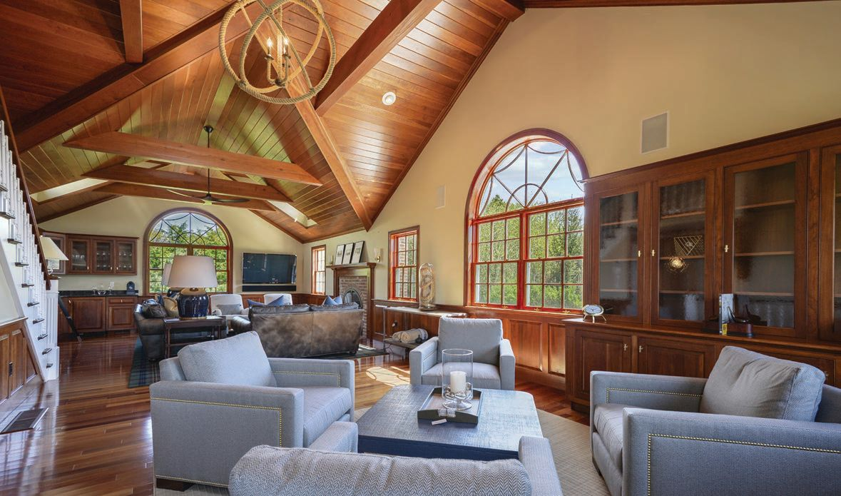 The family room at 16 Aunt Lydia's Way features wood cathedral ceilings and an abundance of natural light PHOTO: BY DRONE HOUSE DIGITAL AND PLANOMATIC